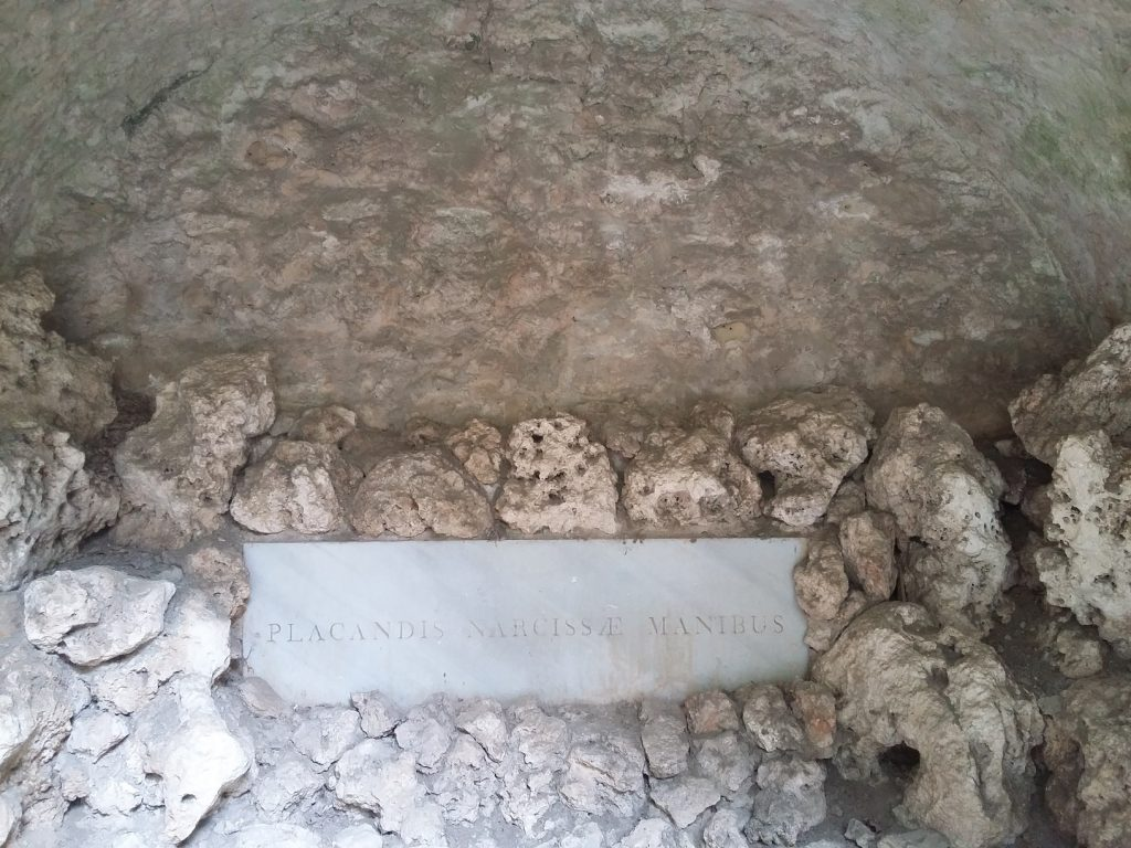 Image of a stone plaque on Narcissa's tomb.