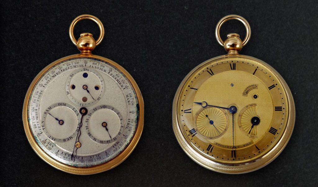 Image of a the front and back of a pocket watch, gold on one side, platinum on the other
