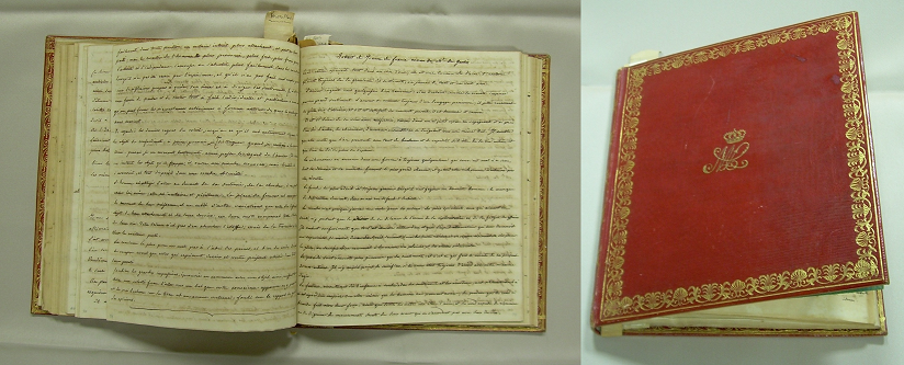 Image of an open manuscript book with a red cover