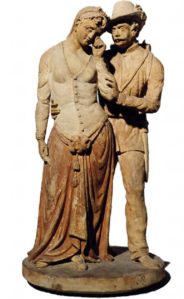 Statue of two figures embracing.